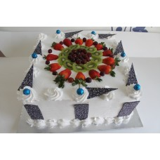 Square tripple delight cake with whipped cream